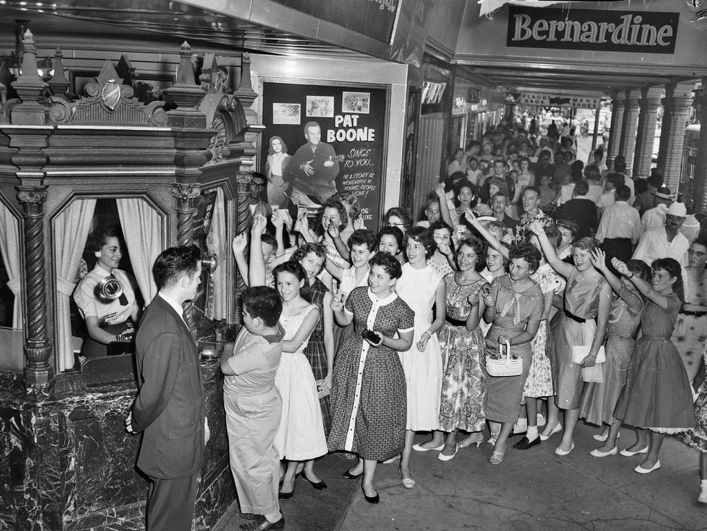 A crowd of patrons, mostly women, stand in line to see Pat Boone perform at the Majestic.