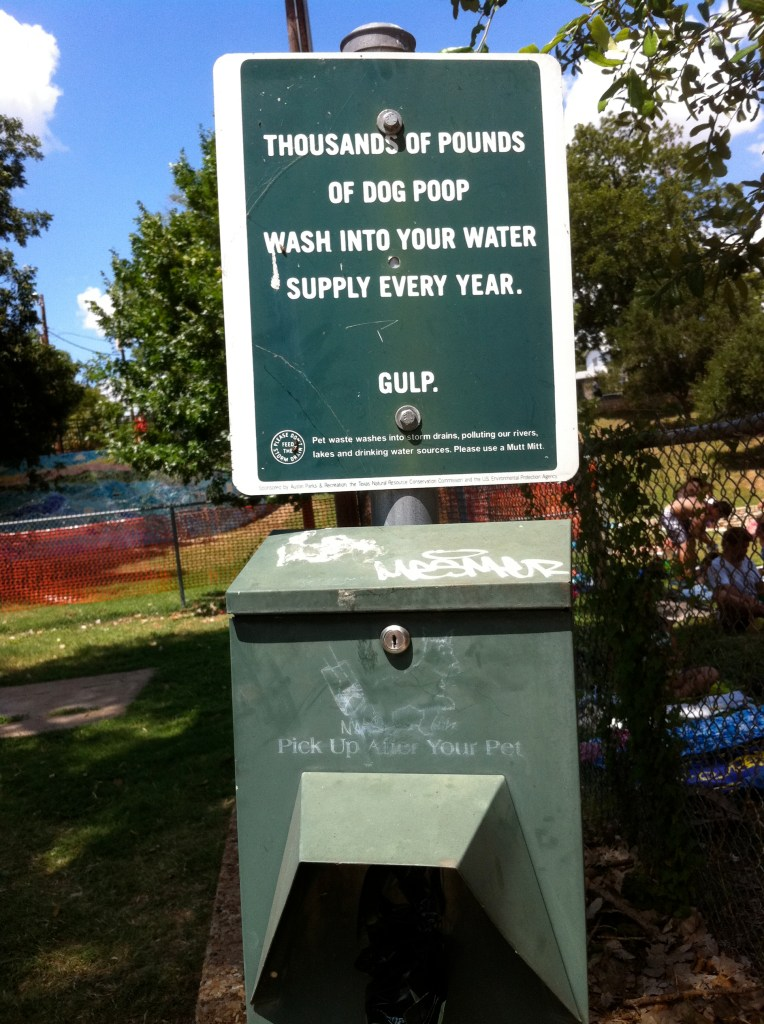 Lady Bird Park uses signage to educate pet owners. Photo by Robert Rivard