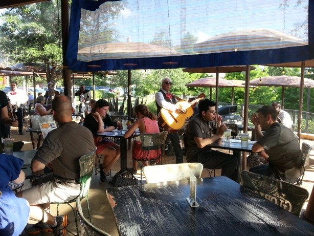 Patrons enjoy music (and the unusually nice Spring-like weather) on the patio at La Gloria earlier this summer. Photo by Georgina Morgan.