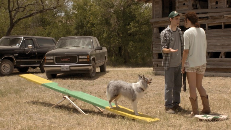 """Cody Linley and Dora Madison Burge train Scout the dog for his role in the film """"Champion."""" Courtesy Photo."""
