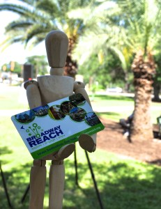 Arty, McNay Museum mascot, poses for a photo with a discounted weekend pass to seven cultural institutions on the Broadway Reach. Photo by Iris Dimmick.