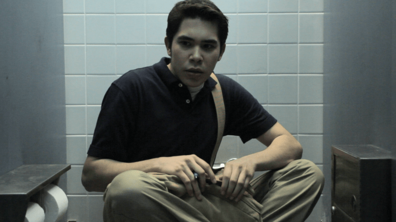 """""""The Symphony of Silence"""" character Zach, played by actor Ben Carlee, hides from bullies in a bathroom. Courtesy photo."""