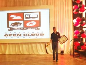 Open Cloud Academy graduate Tyler Dolliver accepts his certificate. Photo by Garrett Heath.