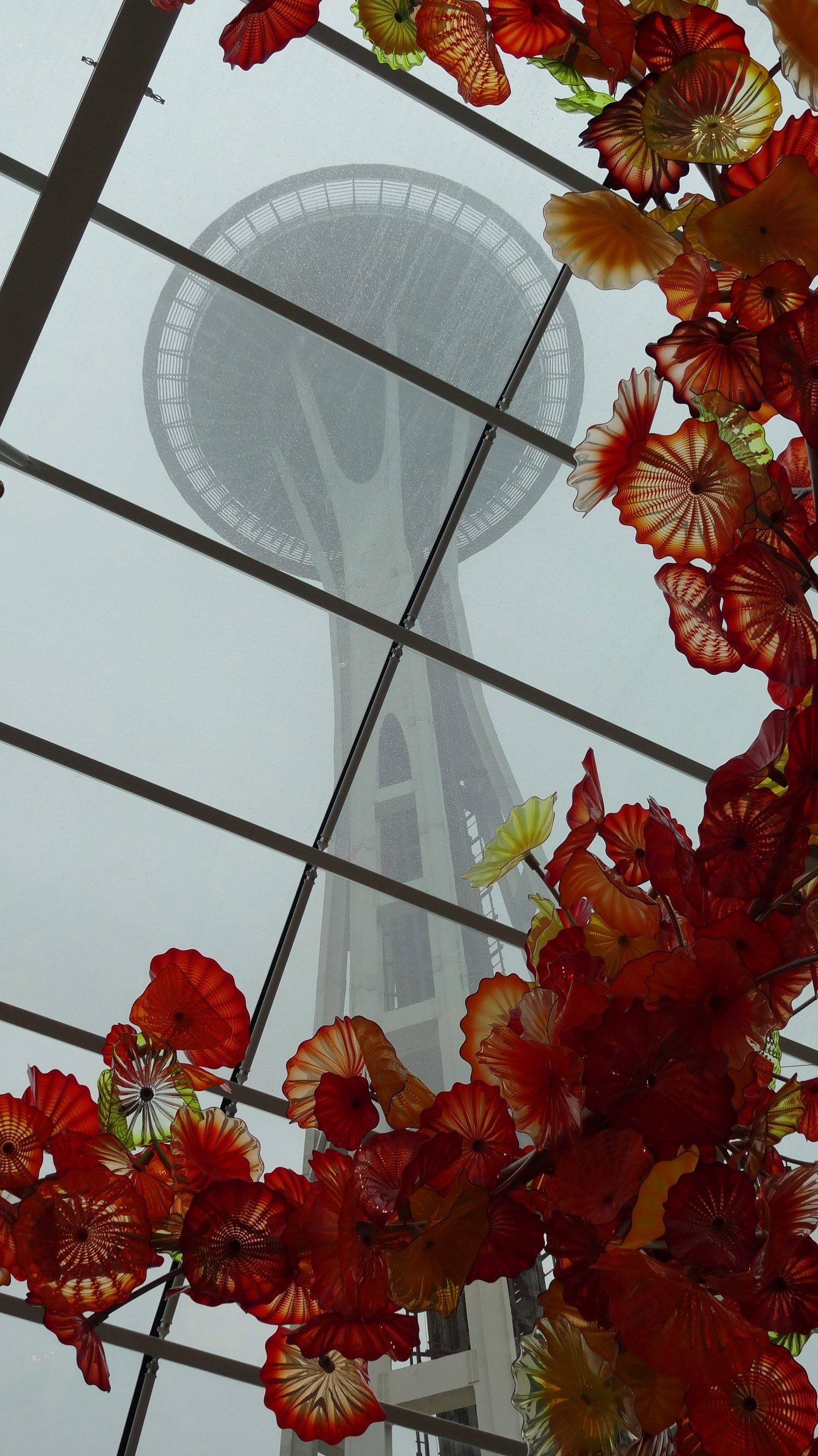 The Space Needle is framed by a glass sculpture at the Chihuly Garden and Glass exhibit in Seattle. Photo by Annette Crawford.