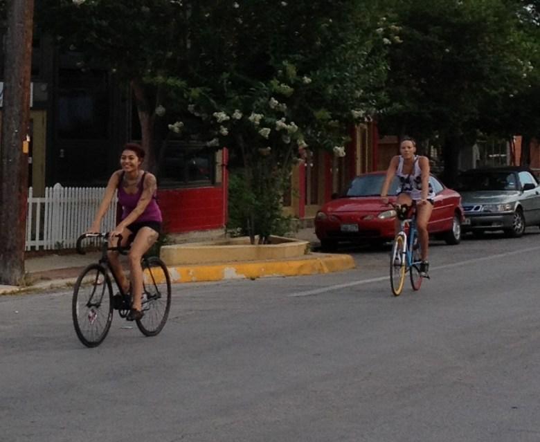Two young women cruising on South Alamo Street. Photo by Robert Rivard