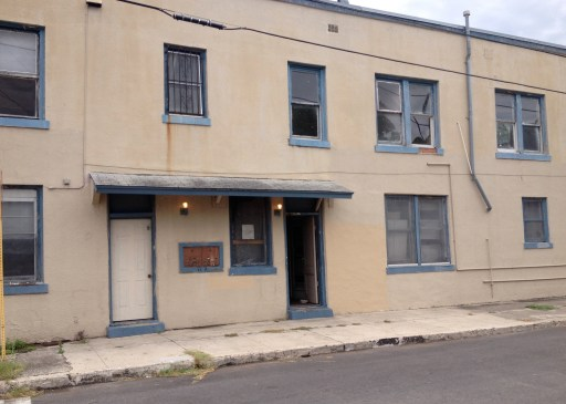 The open windows and door attest to the abandoned Roosevelt Apartments.