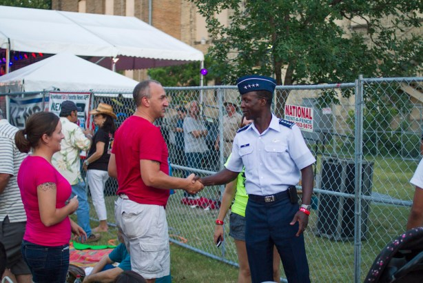 General Rice shakes hands and speaks with audience members after his speech. Photo by Steven Starnes.