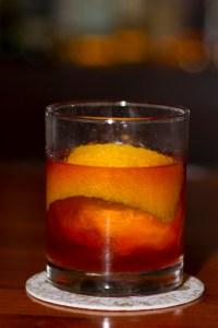 An Old Fashioned, Bohanan's style. Miced by Jordan Corney: sugar cube, angostura bitters, burbon (Buffalo Trace), orange zest/peel. Photo by Steven Starnes.