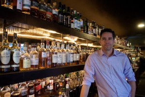 Owner Don Marsh and his whiskies at 1919, downstairs within the Blue Star Arts Complex. Photo by Iris Dimmick.