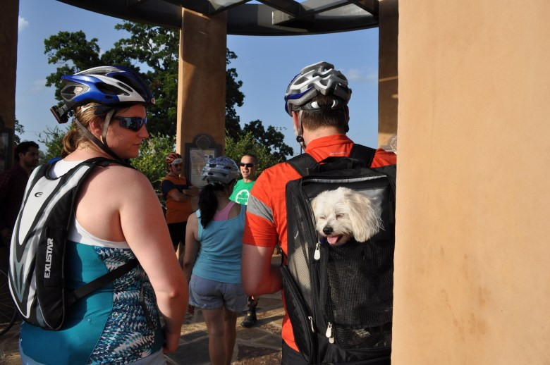 Leah Lemberg, an engineer with Valero, looks on as the presentation continues at Conceptión Park. Sasha, her dog, is ready for more Something Monday action. Photo by Iris Dimmick.