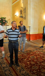 Fr. David Garcia address the Something Monday crowd in the Mission Concepción main chamber. Photo by Iris Dimmick.