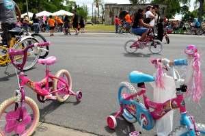 Tricycles await their princesses on Broadway Street during Siclovía 2013. Photo by Iris Dimmick.