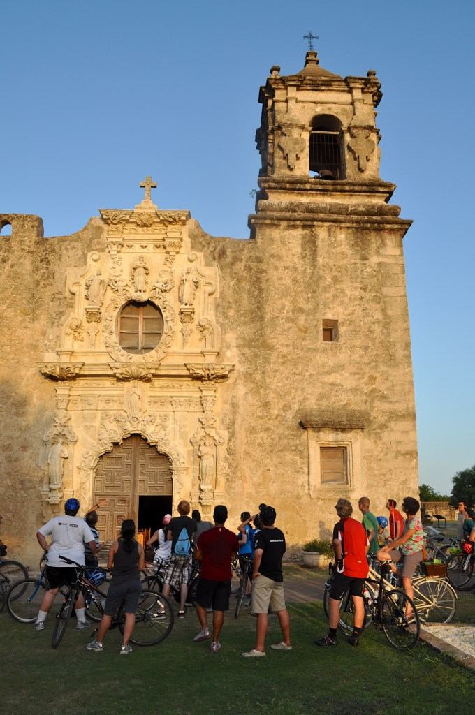 Something Monday/B-cycle riders admire Mission San José, especially photogenic at sunset. Photo by Iris Dimmick.