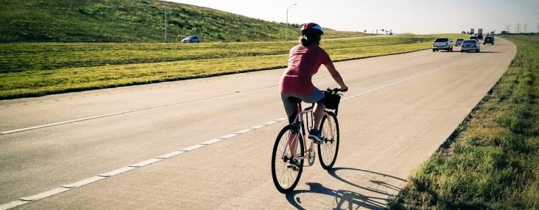 A cyclist uses a TxDOT toll road. Courtesy of Bike Texas.