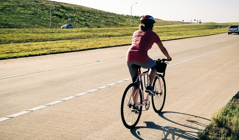 A cyclist uses a TxDOT toll road. Courtesy of Bike Texas.