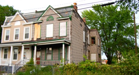 A vacant home (right) wilts away next to its newly renovated neighbor. Photo courtesy of the City of Balimore.