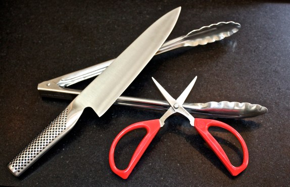 Tricks of the trade: a quality chef's knife, spring-loaded tongs, and Joyce Chen scissors.