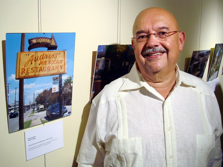 Tony Cantu stands next to his photograph of Audry's Mexican Restaurant