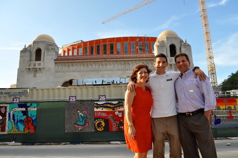 Corine, Anthony, and Michael Wofford pose for a photo at the Tobin Center's main entrance. Photo by Iris Dimmick.