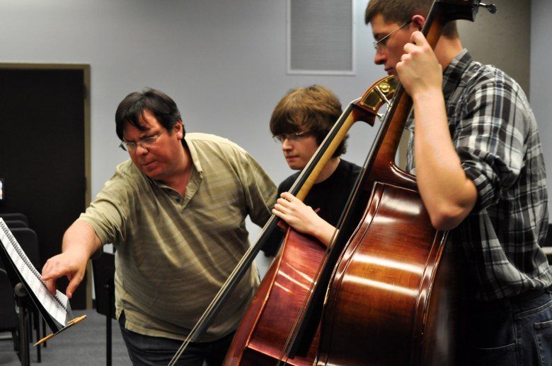 Zeserman instructs young bass players during a 2013 spring YOSA rehearsal. Photo by Iris Dimmick.