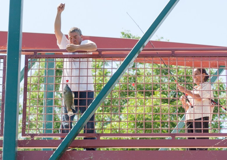 An angler caught a fish (perch) from the bridge while we were paddling by. Photo by Garrett Heath.