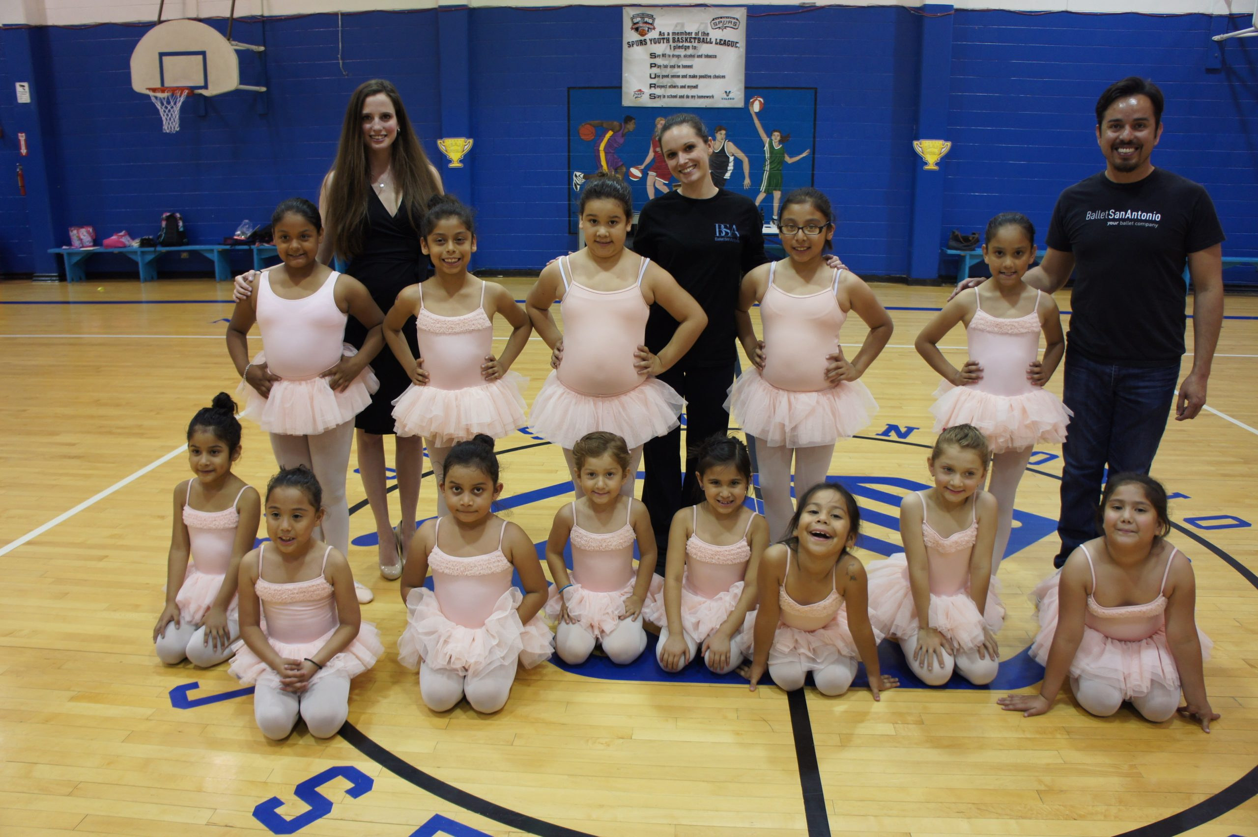 The Boys and Girls Club Ballet class with Courtney Barker (far left) and Gabriel Zertuche (far right). Courtesy Ballet San Antonio.