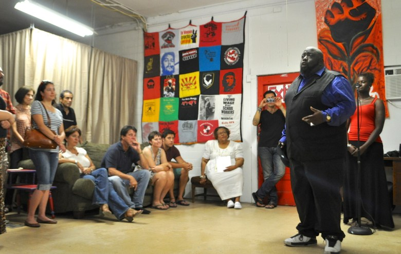 """Poet and radio personality Mondrea """"Urban Griot"""" Harmon at a poetry reading and art show at The Movement Gallery. Photo by Iris Dimmick."""