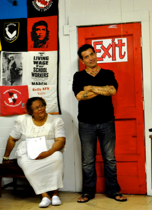 """""""Eastside S.A."""" curator Ernesto Olivo stands next to author, poet and Eastside resident Antoinette B. Franklin during the project's opening reception. Photo by Iris Dimmick."""