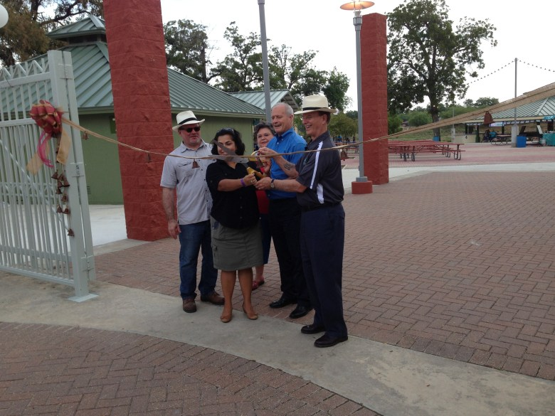 County Manager David Smith, Councilwoman Rebecca Viagran, Betty Bueche, Commissioner Tommy Adkisson, and Judge Nelson Wolff cut the ribbon to reopen Mission County Park Pavilions.