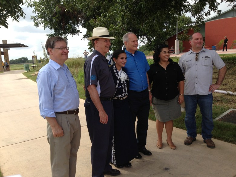 Former Congressman Quico Canseco, Judge Nelson Wolff, Bryanna Rich, Commissioner Tommy Adkisson, Councilwoman Rebecca Viagran and County Manager David Smith on the Mission Reach.