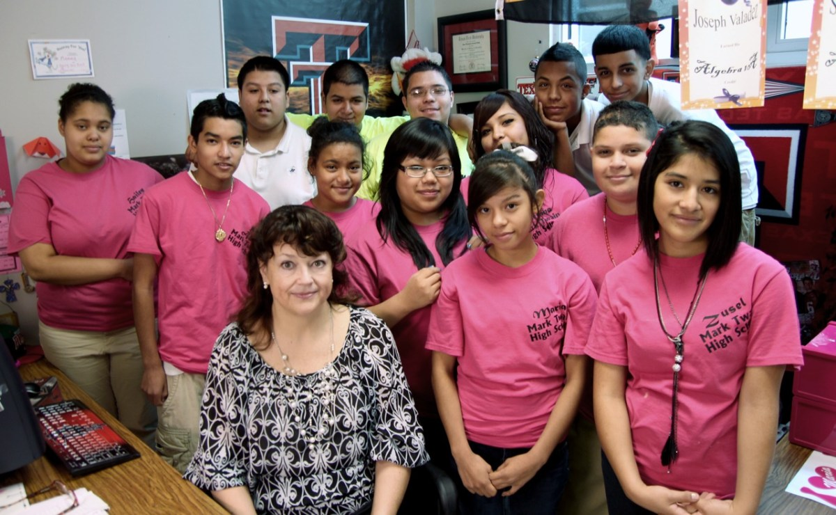 Beth Adams (center) and students in the Middle School Partners Program at Mark Twain Middle School (SAISD).