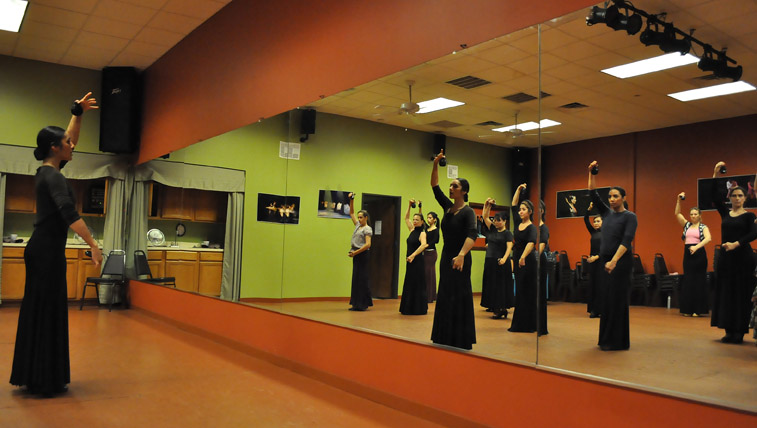 Estafania Ramirez and her class are reflected in the mirror at EntreFlamenco. Photo by Annette Crawford.