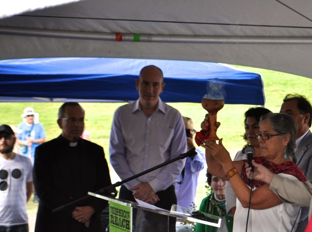 Fr. David Garcia and Irby Hightower look on as Linda Ximenes blesses the Mission Reach during its grand opening ceremony. Photo by Iris Dimmick.
