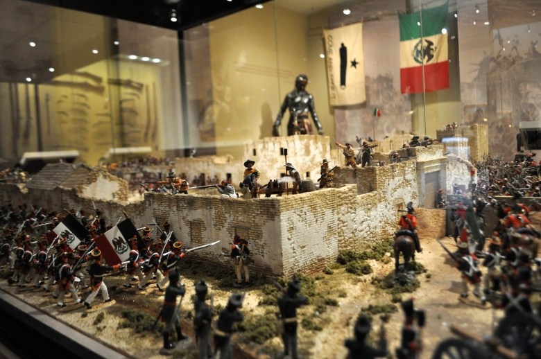 """One of Exhibit Designer Kevin Sayama's favorite pieces in the museum, the iconic Battle at the Alamo. The intricate attention to detail and scale of the model allows the viewer to really """"see the odds"""" that the defenders were up against, Sayama said."""