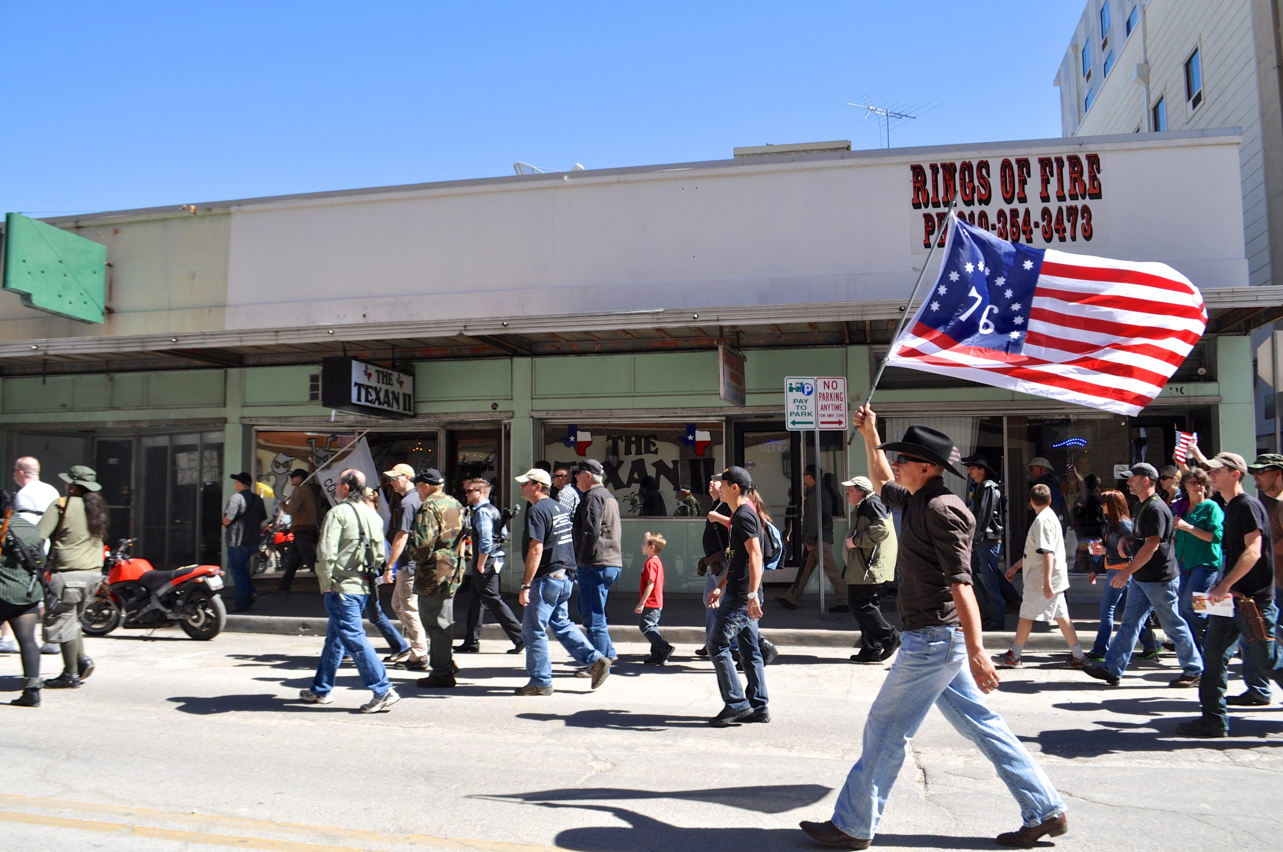 Anti-gun law rally participants walk to Travis Park. Photo by Iris Dimmick.