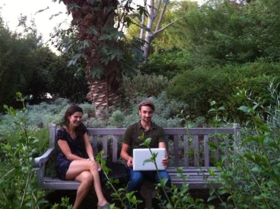 Emily Reynolds and Adam Tutor contemplate the beauty of the garden. Photo credit Betsey Garland.