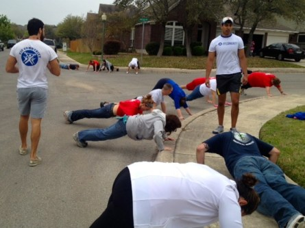 Drop down and give me twenty! Fit Community founders Paul Rezaei and Nathan Gamez direct a workout within a workout. Photo/Liz Estrada