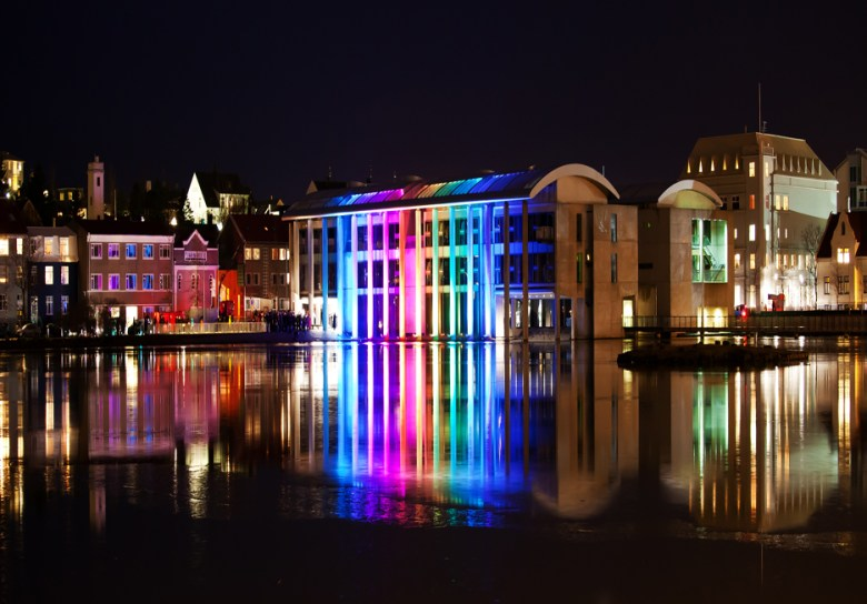"""Bill FitzGibbon's """"Poem of Light"""" lit up the colonnade of the Reykjavík City Hall, Iceland, for the opening ceremonies of Museum Night, creating a dramatic light sculpture that magically transformed the city hall into a spectacular spectrum of moving color. Courtesy photo."""