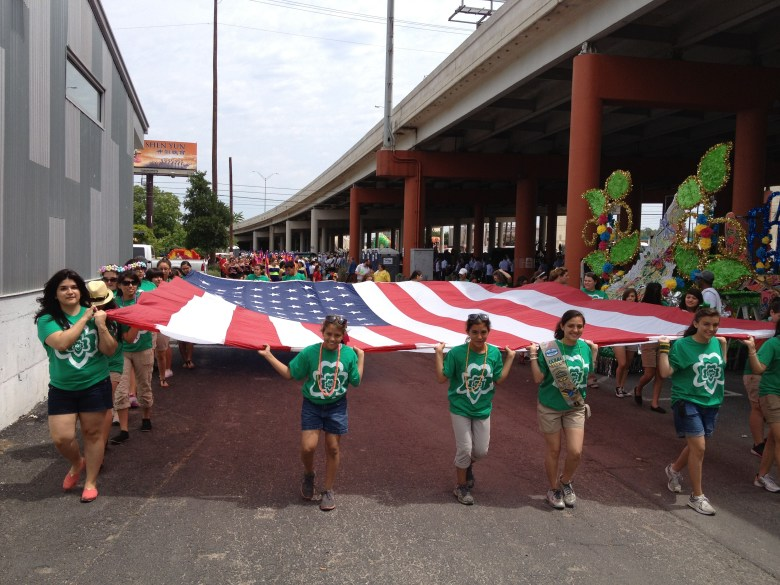 Girl Scouts of Southwest Texas Gamma Sigma Girls Carry the American Flag in the Battle of the Flowers Parade 2012. (Photo courtesy of the Girl Scouts of Southwest Texas.)