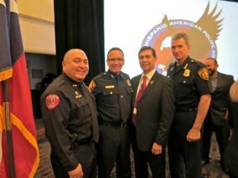 Left to right: Paul Chapa, 2013 Aguila Award recipient Joe Bañales, Tony Chapa, and SAPD police chief William McManus