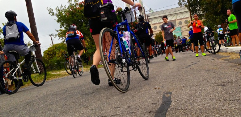 Riders dismount and grab refreshments at the conclusion of the 23 mile bike tour.