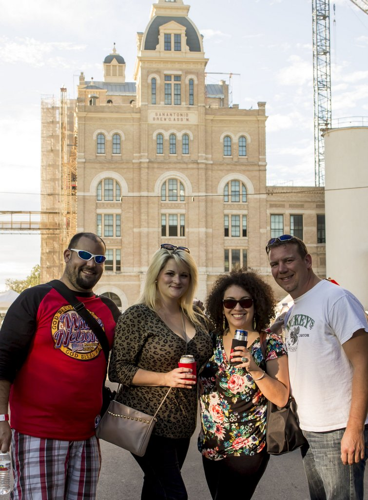 Meatopia attendees pose for a photo during Sunday's festivities at the Pearl Brewery complex. Photo by Jesse Torres.