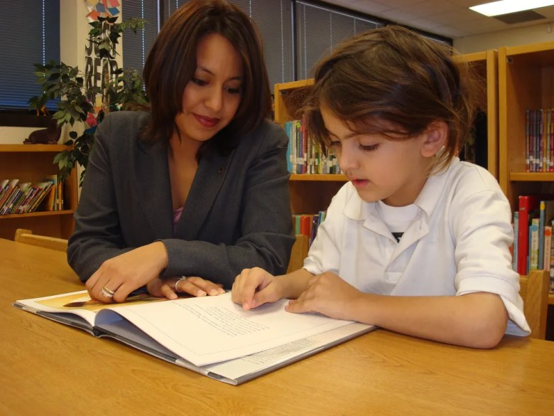 Anita Guiterrez and SAYL reading buddy Emiliano. Photo courtesy of SAYL.