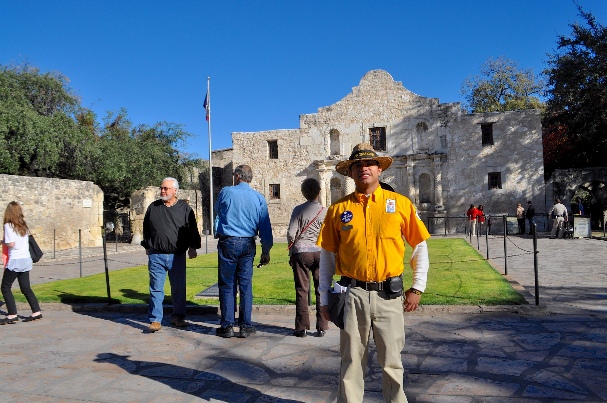 "Marco Ramirez, a Centro San Antonio public service representative (""PSR""), poses for a photo while working Alamo Plaza. Photo by Iris Dimmick."