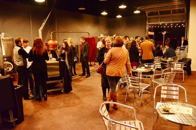 Partygoers in the distillery room. Photo by Page Graham.