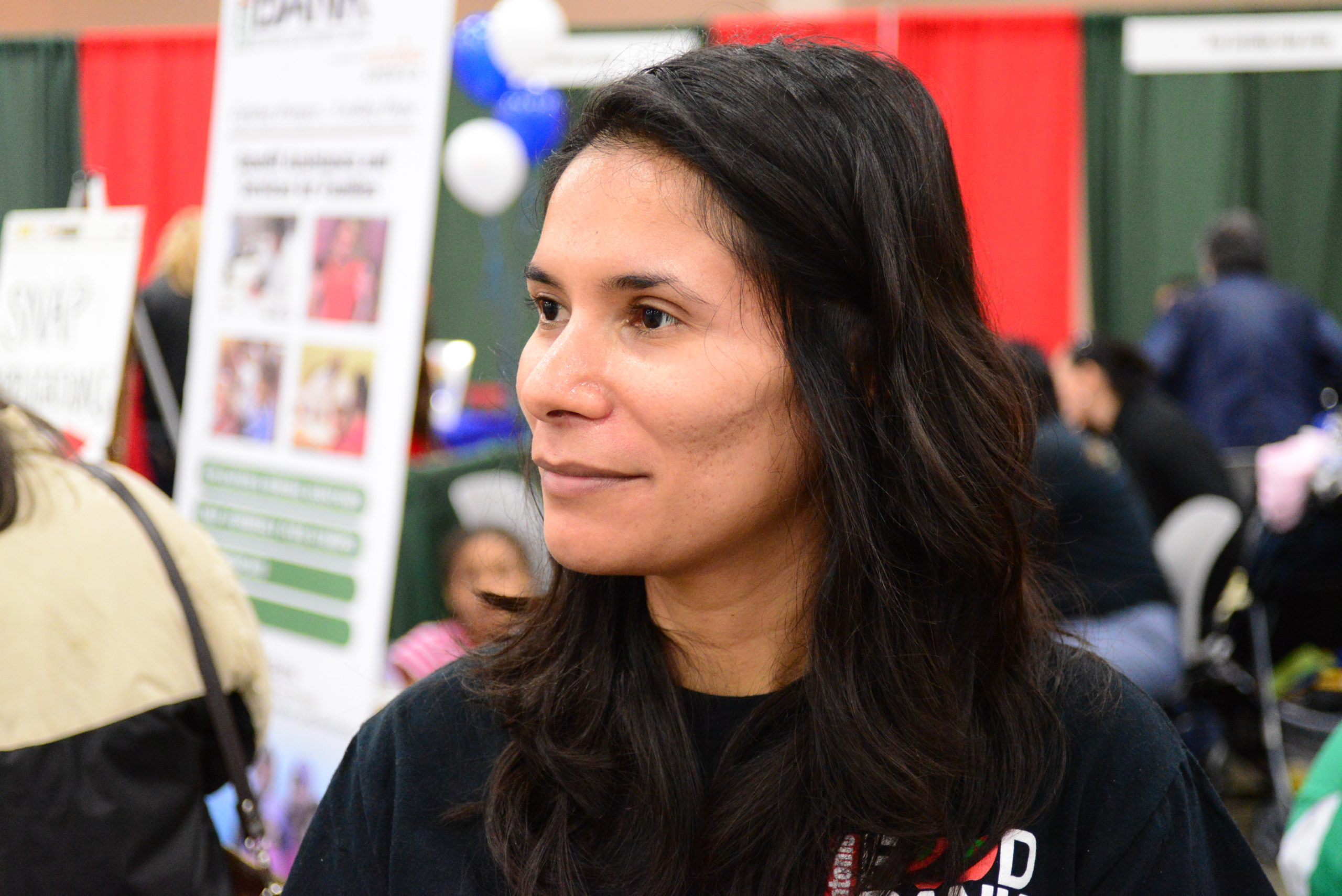 Yesenia Bazan of the San Antonio Food Bank discusses their goals for the Feast of Sharing. Photo by Page Graham.