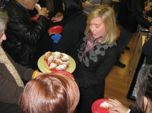 Patrons enjoy the fruits of C'est La Vie Baking Company's labor during their grand opening. Photo by Randy Bear.