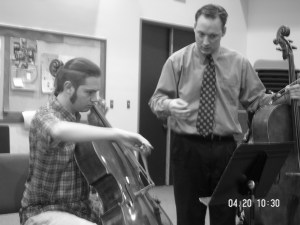 Ken Freudigman with a cello student.