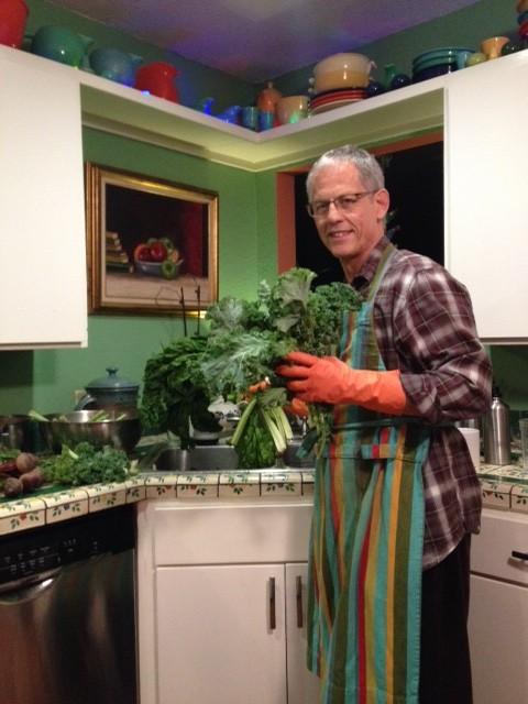 Rudi Harst prepares a leafy bounty. Photo by Mateo Baer Harst.