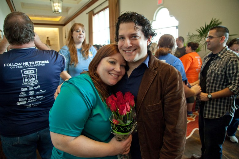 Ashley Kuzar and her boyfriend celebrate her weight-loss success. Courtesy photo.